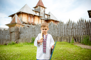 The boy plays with a sword